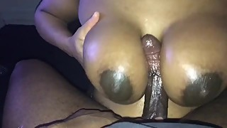 Ebony wife strokes BBC with her titts and makes cum