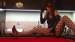 Horny brunette HotwifeVenus kitchen fun with black dildo and latex gloves