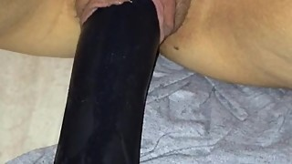 Fucking my wife's tight pussy with a big black dildo